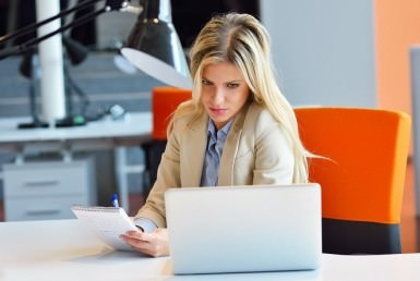 Women looking to a pc in a office