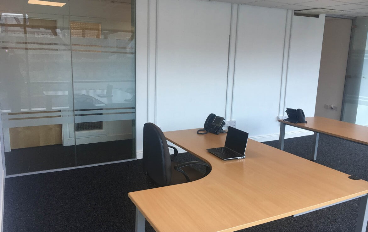 Interior of a Nesta serviced office in Santry with desks, phones chair and laptop